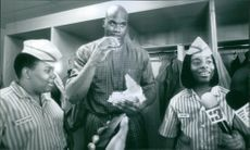 1997 A scene from the film Good Burger. Dexter (Kennan Thompson, left) and Ed ( Kel Mitchell, right) graciously make a  delivery to Shaquille O'neal (center) who craves a Good Burger after a basketball game.