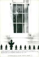 Henry Kissinger on the phone at his office in the White House