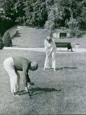 Edgar Faure playing golf with Lucie Faure.