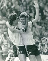 Norman Whiteside with Bryan Robson.