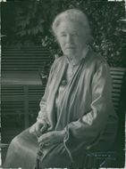 Selma Lagerlöf siting in the chair.