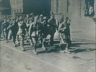 Soldiers marching in street during WWI, 1936.