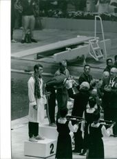 Awarding ceremony of winner athletes.  Taken - Oct. 1964