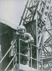 Man wearing space suit standing.