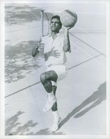 American Jazz singer Johnny Mathis being photographed while playing basketball