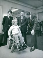 Lord Snowdon discussing the merits of the newly styled wheelchair with Simon Shepherd.