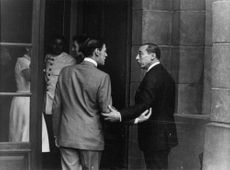 Angus Ogilvy on the door, talking to a man with Princess Alexandra talking to a woman, 1965