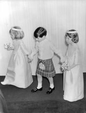 Three children walking for the wedding ceremony of Princess Alexanra of Kent On 24 April 1963, she married the Hon. Angus James Bruce Ogilv at Westminster Abbey.