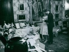 Carl, Duke of Württemberg and Princess Diana, Duchess of  Duchess of Württemberg standing in a room and looking in a piece of paper.