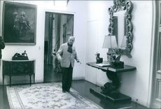 William Somerset Maugham standing at the room, 1965.