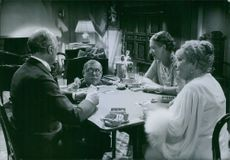"""People playing cards and enjoying.  1936 """"Family Secret"""" Bullen Berglund Sbjordis Petterson Carin Swanstrom"""
