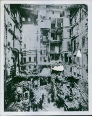 """People standing within a totally damaged place.  """"tomorrow __"""""""