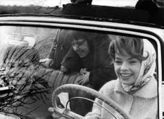 Pascale Petit driving car with children.