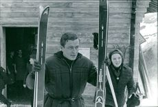 Beatrix and Claus of the Netherlands holding skis.