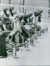 Women standing together ringing the bells.