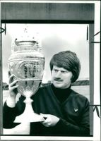 Peter McEvoy holding his trophy.
