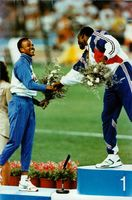 Linford Cicero Christie shaking hands with other sportsman.