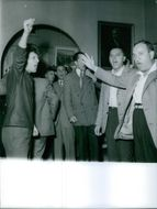 Men standing inside the house and shouting slogans.
