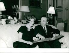 Edwina Sandys and husband Piers John Shirley Dixon looking at a photo album.  - Nov 1960