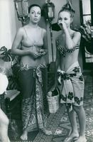 It seems two lady have prepared for sunbath. 7 Aug 1968