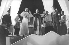 Pope Paul VI with his hands spread in air.