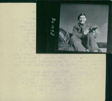 Lance Corporal John Taylor happily write a letter to his family.