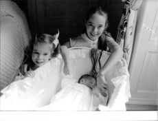 Charlie Chaplin's daughters and the newborn baby.