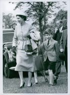 H.M. Queen Elizabeth II with her two children, Prince Charles and Princess Anne, arrived for the final day of the Windsor Horse Show. 1956.