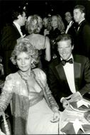 Roger Moore and his wife Luisa at Cartier Perfumes gala dinner at the Parc de l'Orangerie
