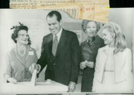 President Richard Nixon leaves his voice in the San Clemente election hall, where he together with his wife Pat and daughter Tricia voted