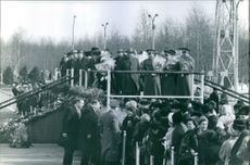 Vintage photo of people gathered to welcome back Alexey Arkhipovich Leonov. Photo taken on March 25, 1965.