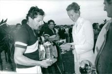 Princess Maria Gabriella giving trophy to a player.
