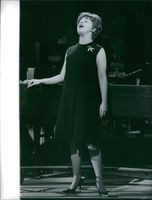 Carol Sloane singing on stage.