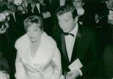 "Simone Signoret and Yves Montand at the premiere of the ""Grand Prix"""