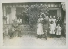 Soldiers looking the villagers while in the street during Tyskland war.