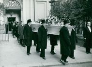 The actor Anders Henriksson's coffin is carried out of Adolf Fredriks Church after the earthquake