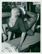 Eartha Kitt in gymnastics bag