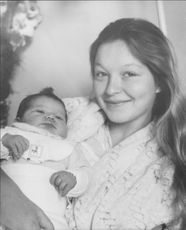 Marina Vlady with baby child in her arms.