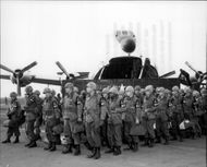 Group of Military Police from the 2nd Armored Division Forthood, Texas,  arrive at the Rhein Main Air Base in Germany