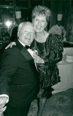 """Mickey Rooney is congratulated by his wife Jan on the opening night of """"Sugar Babies"""""""