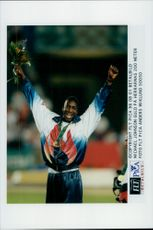 Michael Johnson wins gold for 200 meters during the Olympic Games in Atlanta.