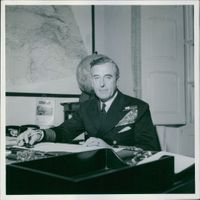 Louis Mountbatten in his desk while he checking the paper.