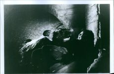 """View of a woman in cave, screaming loudly due to the animal standing beside her.  """"Food Of The God3""""  1992"""