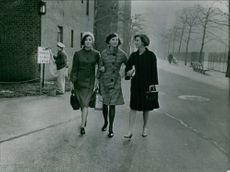 The Dee Sisters walking on the street.