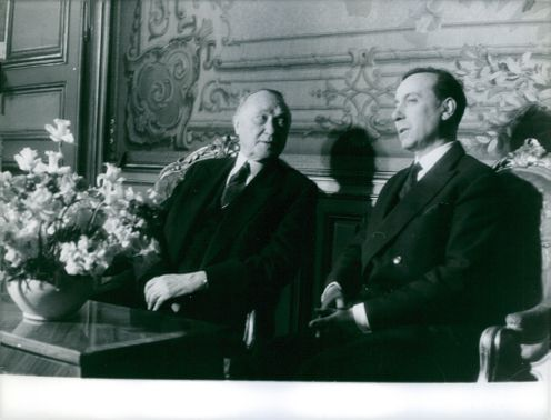 Former German chancellor Konrad Adenauer have sat with former French Prime Minister Michel Debré, they are discussing about something