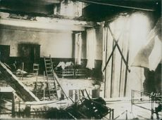 Inside view of a ruined house during wartime.