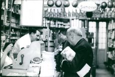 Georges Bidault at a grocery store cashier.  - Dec 1964