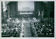 Soldiers in the church while the priest having a mass in Sweden during World War II, 1940.