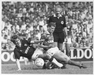 Gary Mackay and Ian Durrant fight for the ball