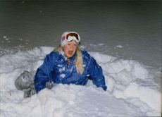 Girl playing in the snow during winter.